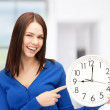 Woman holding big clock - Stock Photo