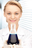 Lab worker holding up test tube — Stock Photo