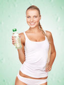 Young beautiful woman with bottle of water — Stock Photo