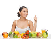 Woman gives thumbs up with fruits and vegetables — Stock Photo