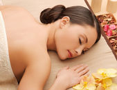 Woman in spa salon lying on the massage desk — Stock Photo
