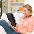 Woman with tablet pc computer or touchpad indoors — Stock Photo #23315812