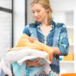Lovely housewife with towels — Stock Photo #23315824