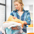 Lovely housewife with towels - Stock Photo