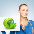 Woman with illustration of green eco globe — Stock Photo #23316494