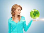 Woman holding green globe on her hand — Stock Photo