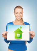 Woman with illustration of green eco house — Stock Photo