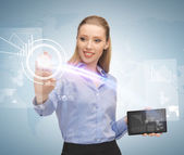 Woman working with tablet pc and virtual screen — Stock Photo