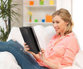 Woman with tablet pc computer or touchpad indoors — Stock Photo