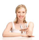Young smiling woman with glass of water — Stok fotoğraf