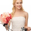 Country girl with bicycle and flowers — Stock Photo #23386382