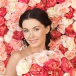 Woman with background full of roses — Stock Photo #23387064