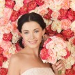 Woman with background full of roses — Stock Photo