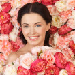 Woman with background full of roses — Stock Photo #23387184