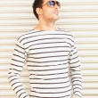 Handsome man in casual clothes  wearing sunglasses - Stock Photo