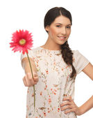 Young and beautiful woman with flower — Stock Photo