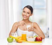Woman with healthy breakfast and measuring tape — Stock Photo