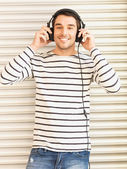Man in casual clothes with headphones — Stock Photo