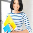 Smiling student with books and notes — Foto Stock
