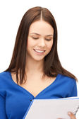Smiling young businesswoman with notebook — Stock Photo