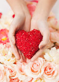 Woman's hands holding heart — Stock Photo