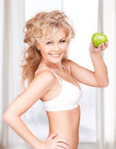 Young beautiful woman with green apple — Foto de Stock