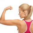 Sporty woman showing her biceps — Stock Photo #24010871