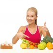 Woman pointing at healthy food — Stock Photo #24011023