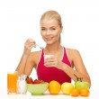 Young woman eating healthy breakfast — Stock Photo #24011157