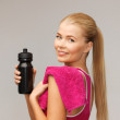 Sporty woman with special sportsman bottle - Stock Photo