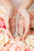 Woman's hands showing perfume — Stock Photo