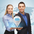 Man and woman with virtual email sign — Stock Photo