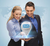 Man and woman with virtual email sign — ストック写真