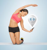 Beautiful sporty woman doing exercise — Stock Photo