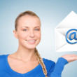 Stock Photo: Womshowing virtual envelope