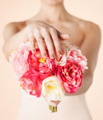 Bride with bouquet of flowers and wedding ring — Stock Photo