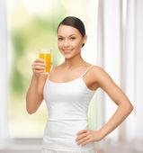 Woman holding glass of orange juice — Stock Photo