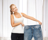 Sporty woman showing big pants — Stock Photo
