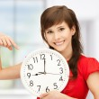 Teenage girl holding big clock — Stockfoto