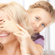 Happy mother and little girl — Stock Photo #24371461