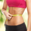Trained belly with measuring tape — Stock Photo #24374465