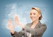 Businesswoman touching virtual screen — Stock Photo
