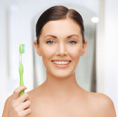 Woman with toothbrush — Stock Photo