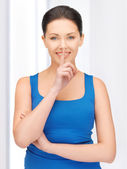 Woman making a hush gesture — Stock Photo