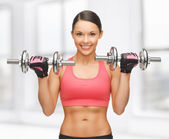 Woman with dumbbells — Stock Photo