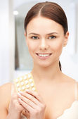 Young beautiful woman with pills — Stock Photo