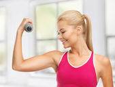 Young sporty woman with light dumbbell — Foto de Stock