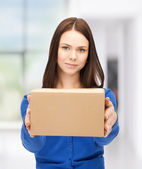 Businesswoman delivering box — Stock Photo