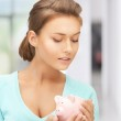Lovely woman with piggy bank — Stock Photo #24683077