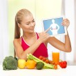 Woman with fruits, vegetables and tablet pc — Stock Photo #24685053